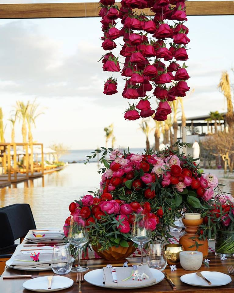 red flowers floating table chileno bay resort elena damy cabo wedding designers