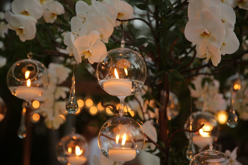 decorative metal tree with hanging candles and orchids cabo wedding designers elena damy