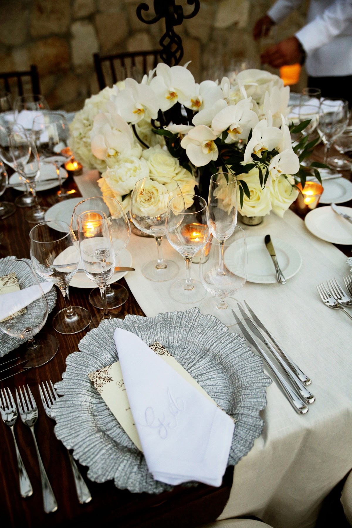 wooden tables mercury glass vases white orchids cream roses white hydrangea mexican wedding designers