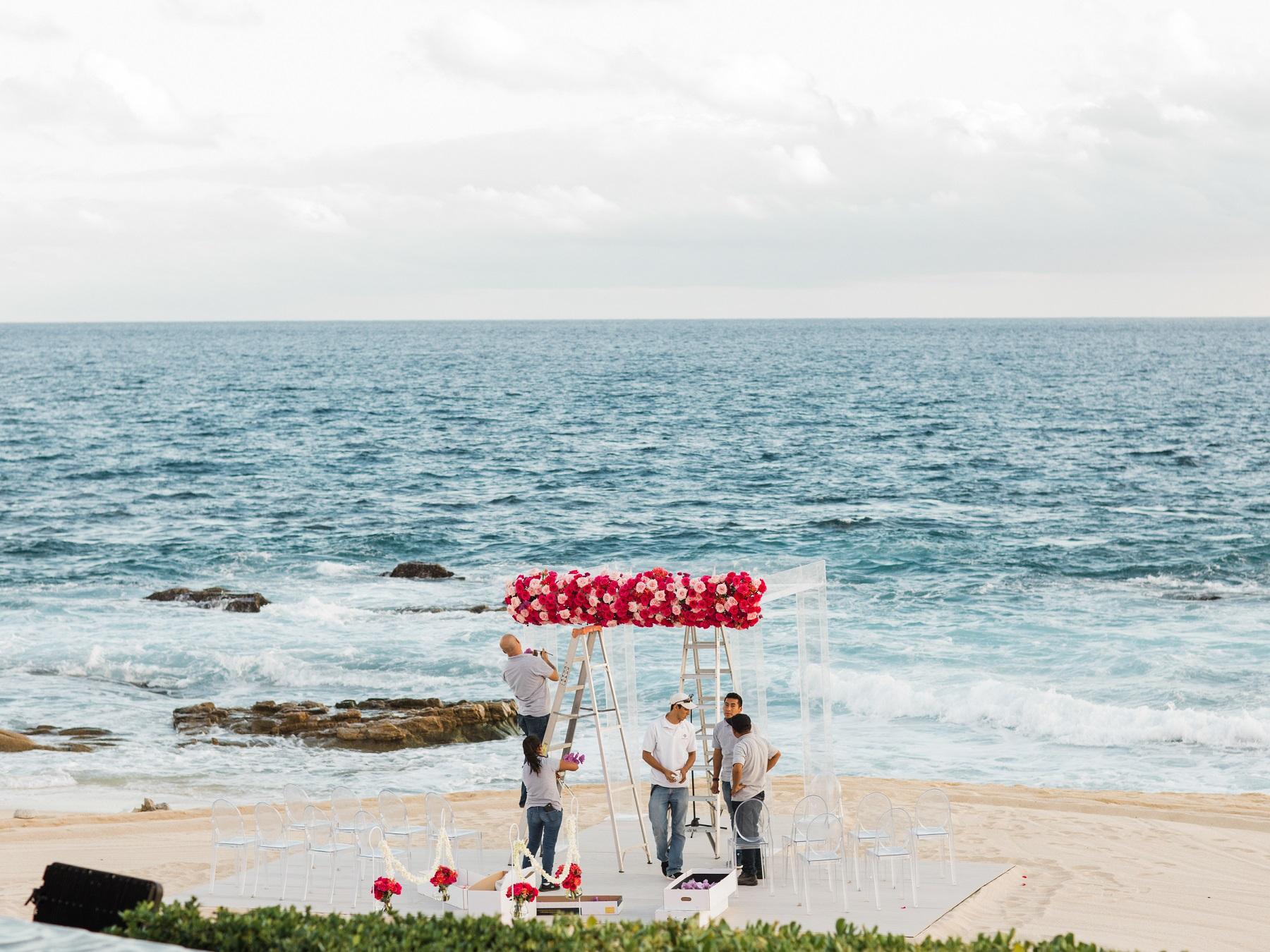 floral ceremony arch on the beach cabo san lucas elena damy destination weddings