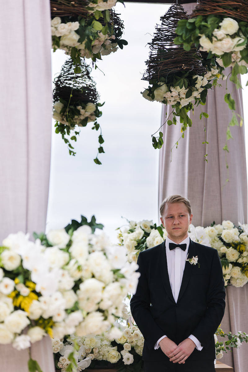 hanging floral arrangements outdoor wedding ceremony