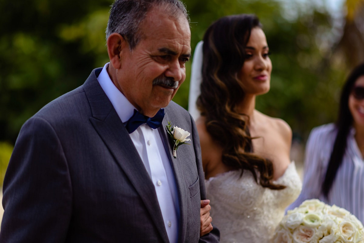 father walking daughter down the aisle church wedding