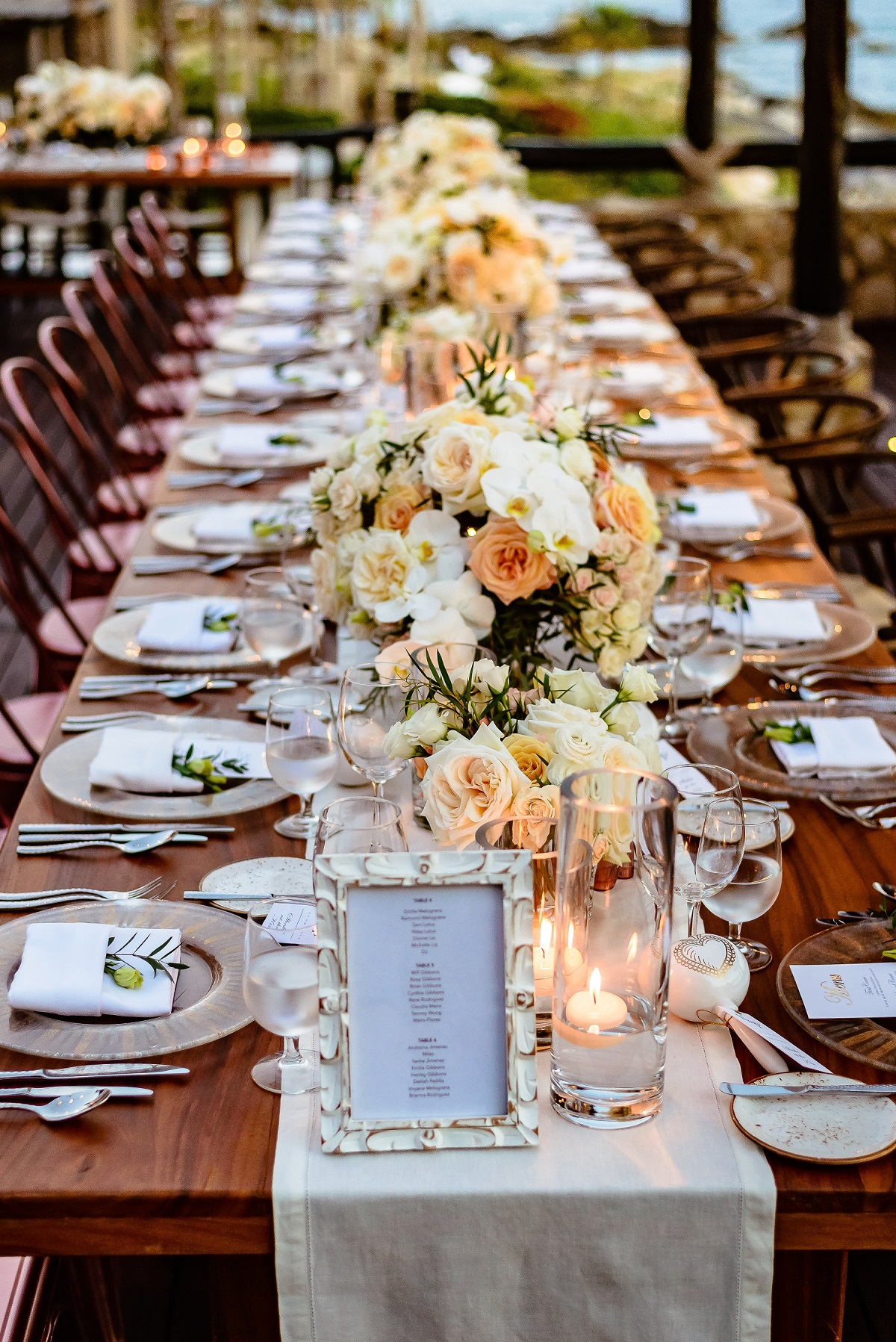 long table floral centerpieces sunset wedding mexico