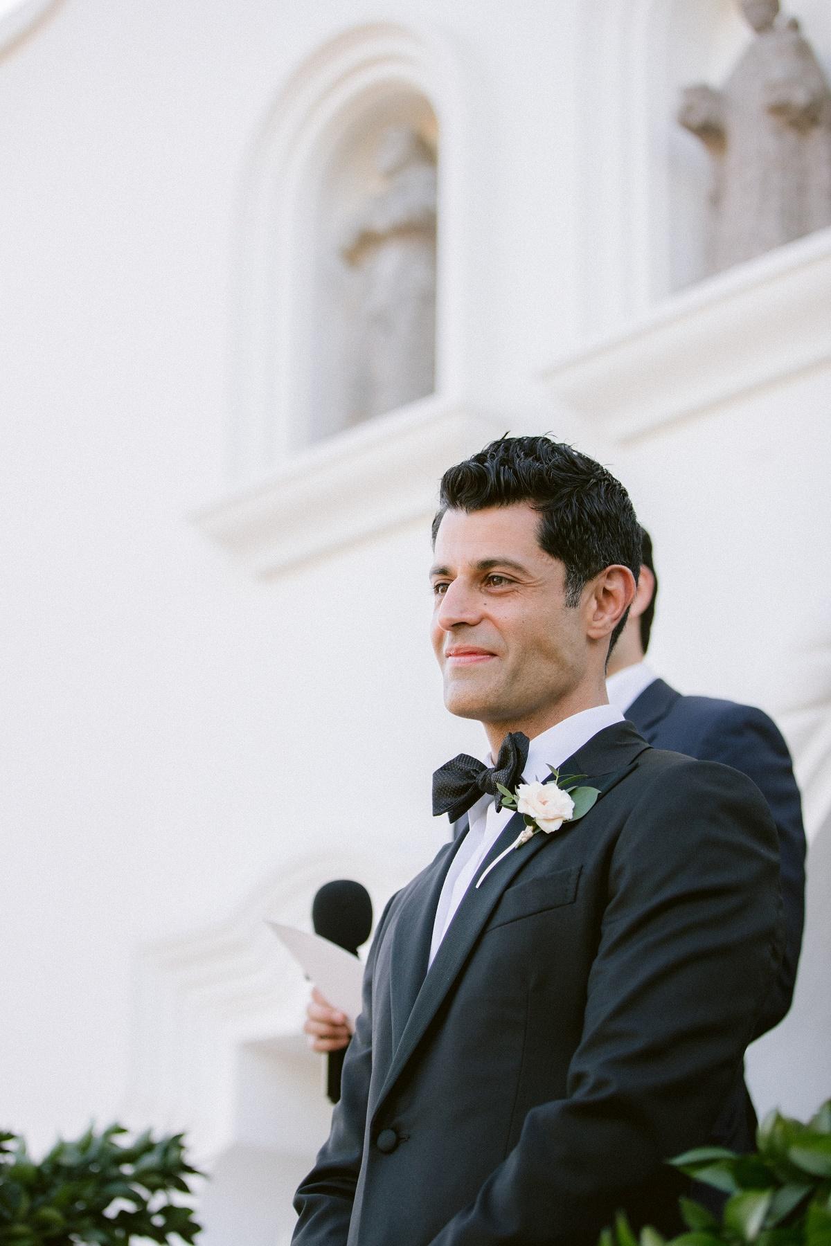 groom watching bride arrive