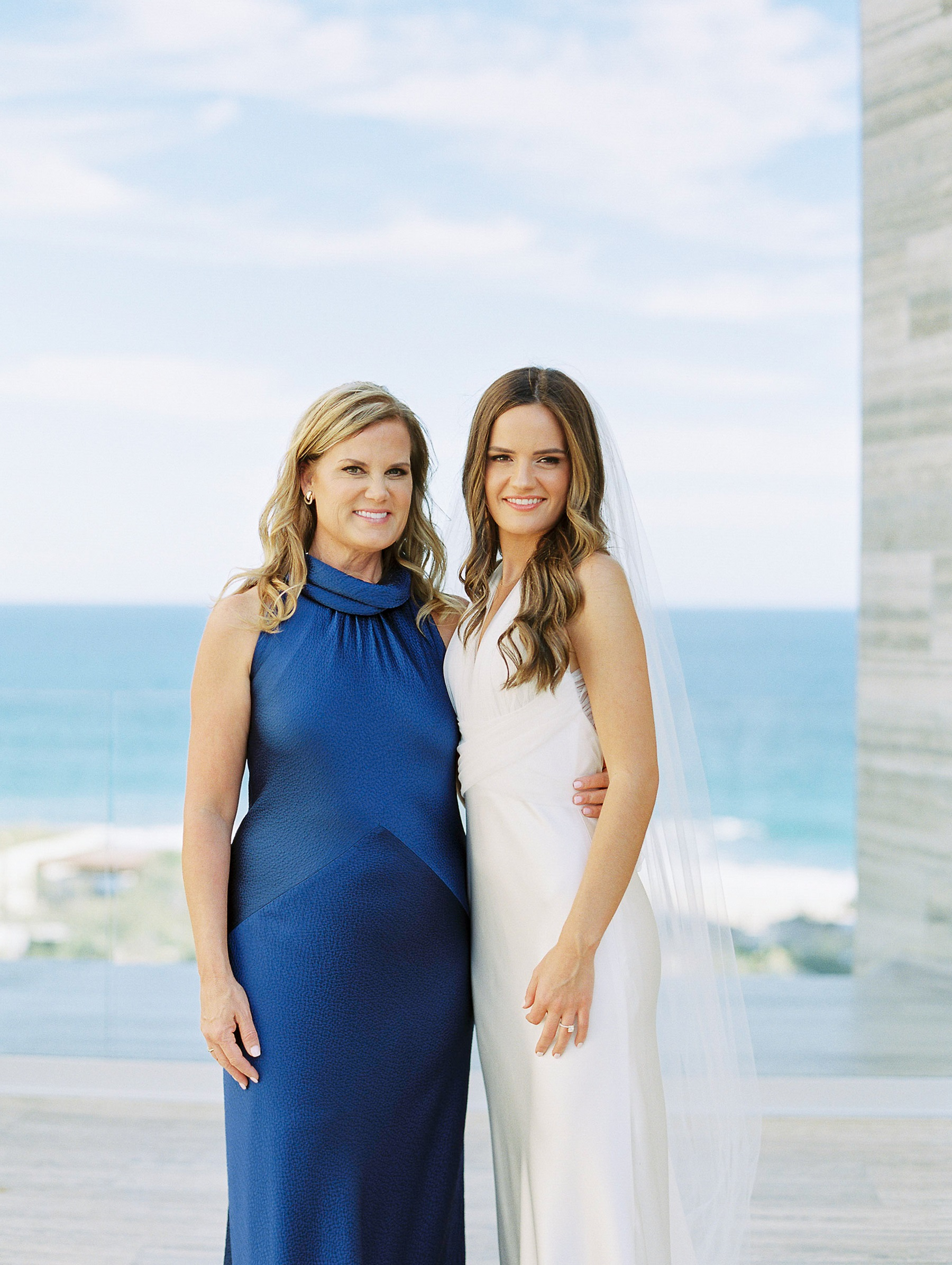 mother of the bride wearing blue dress