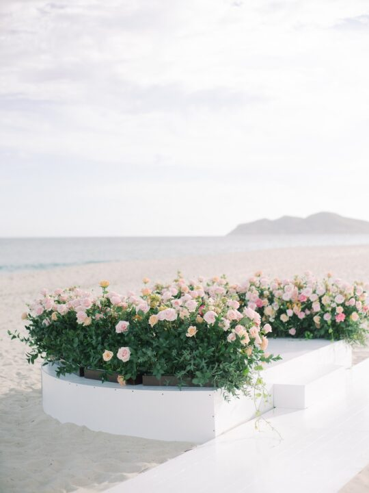 pink and white wedding ceremony decor cabo