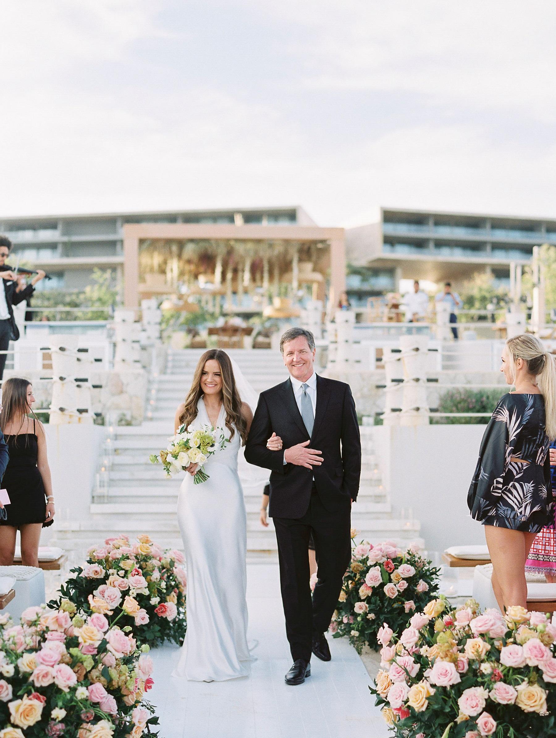 bride's entrance beach ceremony solaz resort cabo